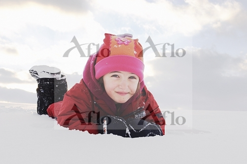 Girl laying down in snow, Stayner, Ontario